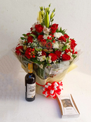 Red themed water bouquet with Four cousins red wine and Belgian Guylian chocolates by Simona Flowers