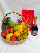 Fruit basket, wine and chocolate by Simona Flowers