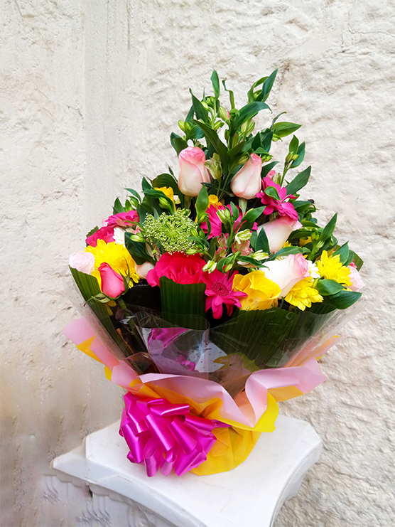 A nice water bouquet mixture of roses, alstroemeria and chrysanthemums