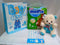 So sweet new baby package of diapers and teddy bear and card by Simona Flowers