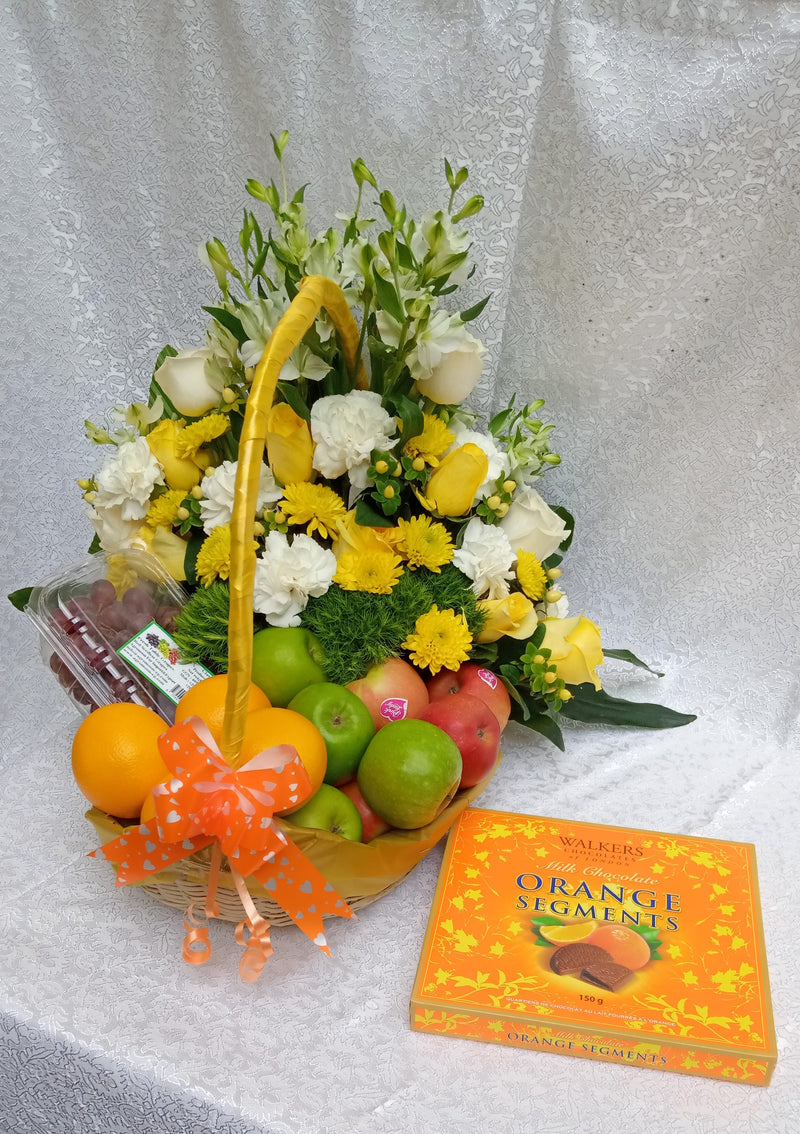 Fruits and flowers combo sided with a box of orange segment chocolates