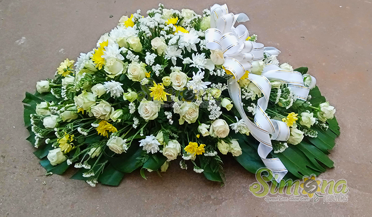Warm embrace casket spread flowers by Simona Flowers