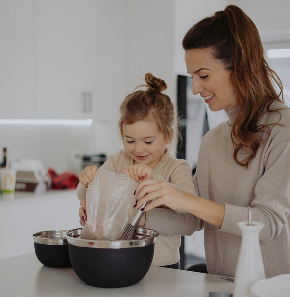 girl and mother preparing mother's day menu