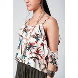 Ecru top with cold shoulder and leaves print