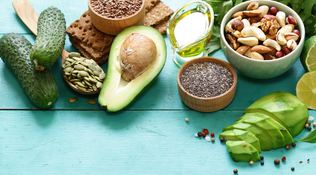 Image: Avocados, Seeds, Nuts and Veggies on a aqua wooden background.