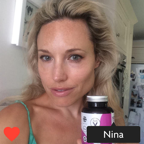 Instagram style image with Nina tagged in. Nina is holding a pot of Vitamini Advanced Collagen Supplements. Nina is smiling and has glowing skin.