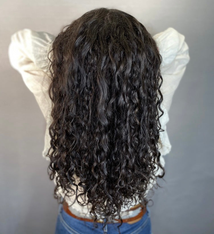 Woman with curly hair extensions