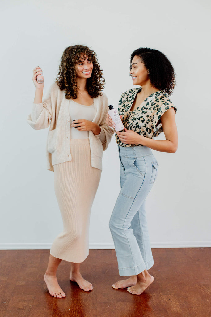 Two models with curly hair had a Devacurl appointment.