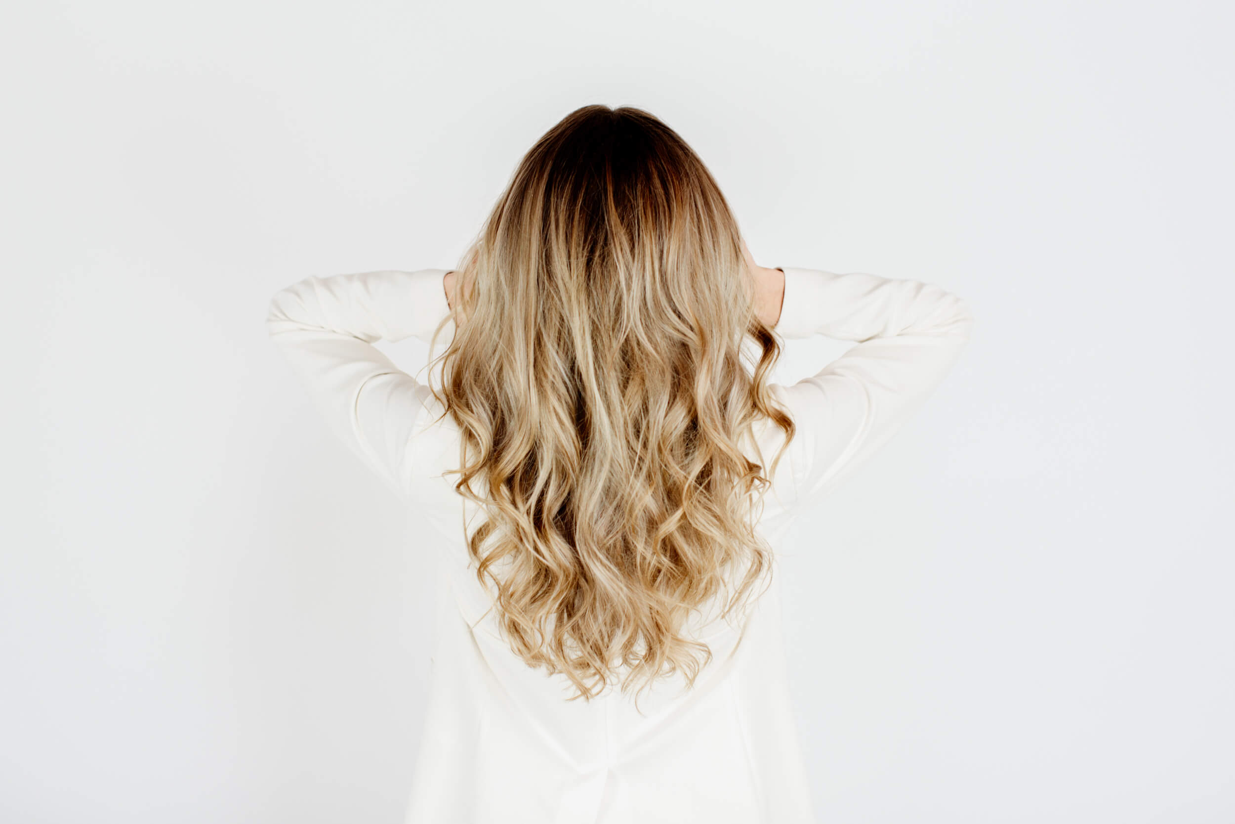 Blonde hair as shown from the back.