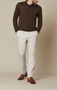 man is wearing a slim fitting pant in beige with a stretch