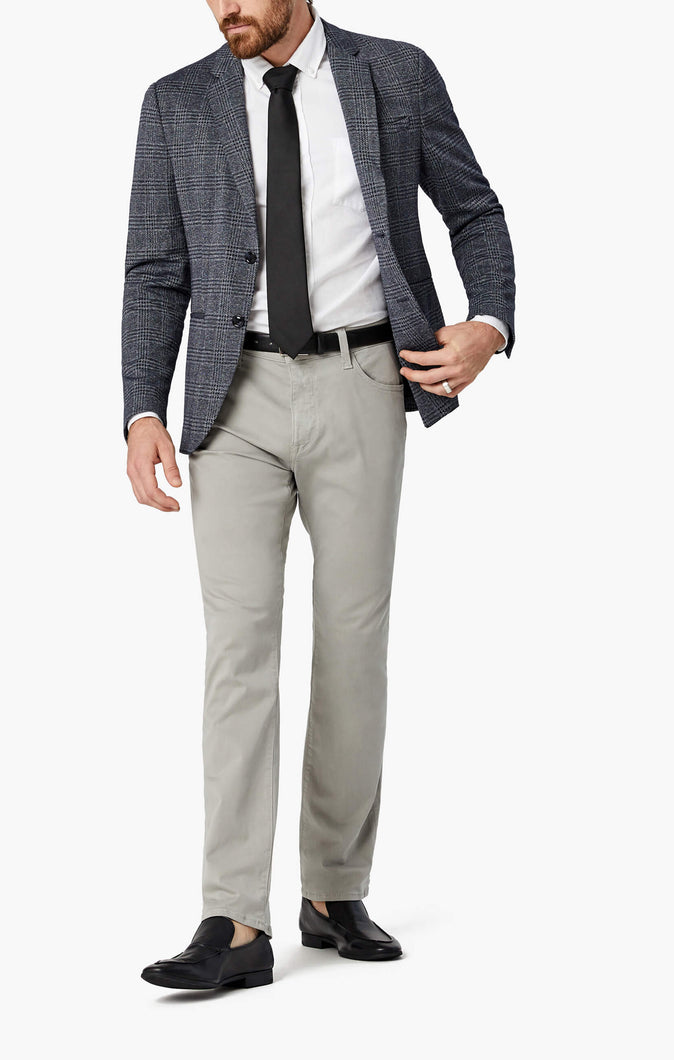 Man is wearing a straight leg grey pant that has slight stretch
