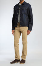 Load image into Gallery viewer, man is wearing a dark denim jean jacket that is fitted and has slight stretch
