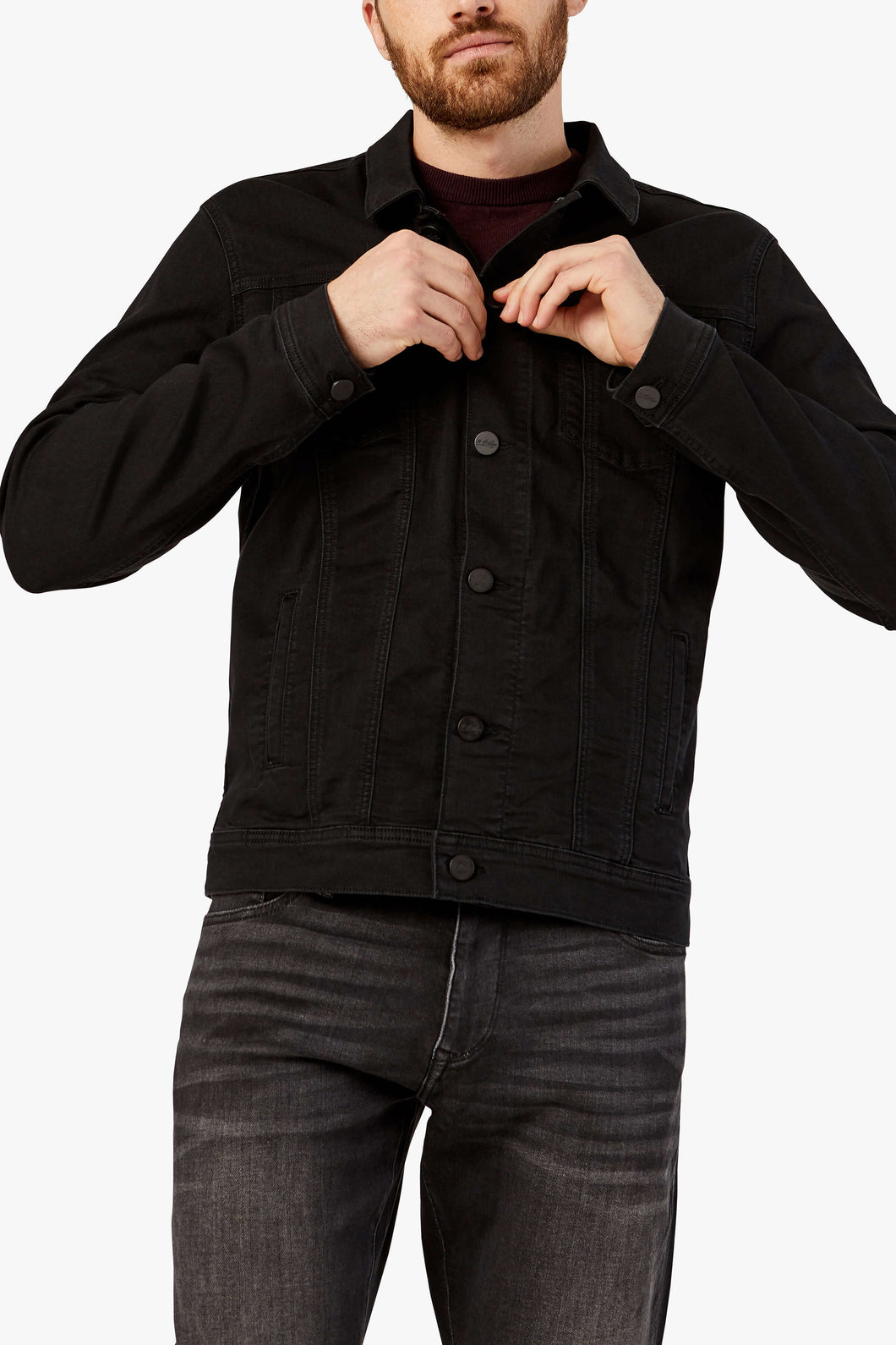 man is wearing a black brushed denim jean jacket that is fitted