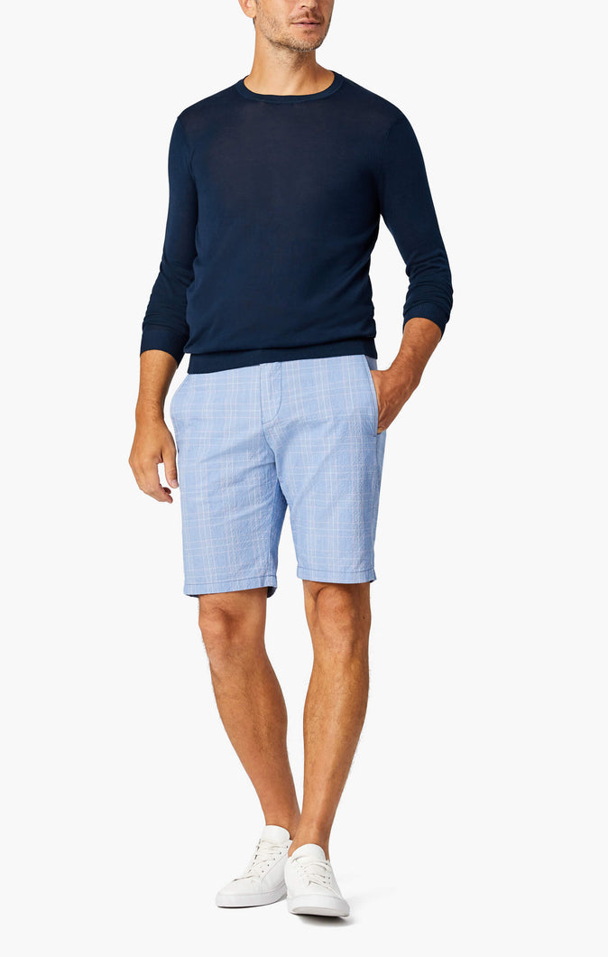 man is wearing cotton blue checkered seer sucker shorts
