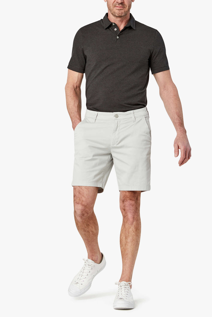 man is wearing cotton shorts in a stone washed twill