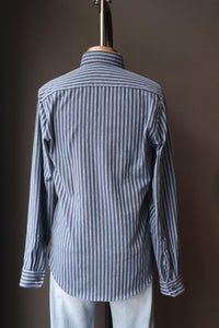 mannequin is wearing a navy/light blue stripped shirt made of Japanese fabric