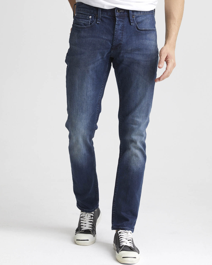 man is wearing mid wash the Razor is an easy, every-day cut featuring a slim, contemporary fit jean