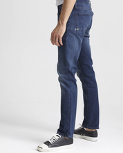 Load image into Gallery viewer, man is wearing mid wash the Razor is an easy, every-day cut featuring a slim, contemporary fit jean