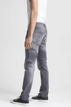 Load image into Gallery viewer, Man is wearing Ace Grey is an 11oz, comfort stretch denim fabric