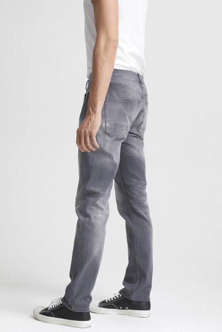 Man is wearing Ace Grey is an 11oz, comfort stretch denim fabric