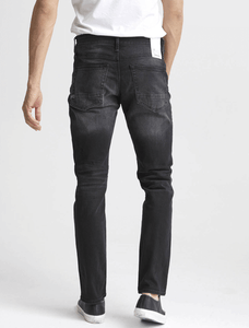 man is wearing Ace Black is an 11oz, comfort stretch jean, crafted from denim with a black warp and weft