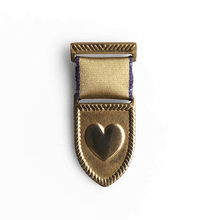 Load image into Gallery viewer, brass heart medal with gold and purple trimmed ribbon