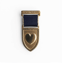 Load image into Gallery viewer, handcrafted heart medal brass with a navy/gold ribbon
