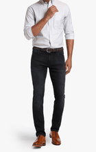 Load image into Gallery viewer, Man is wearing a slim leg jean in a mid rise