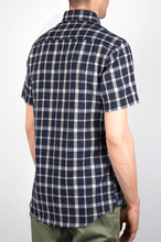 Load image into Gallery viewer, Man is wearing short sleeve plaid navy blue and light blue short sleeve shirt