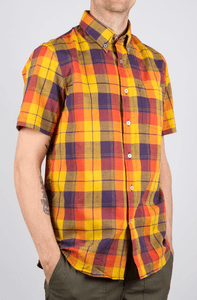 Man is wearing a linen mix plaid short sleeve shirt yellow/purple pattern