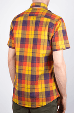 Load image into Gallery viewer, Man is wearing a linen mix plaid short sleeve shirt yellow/purple pattern