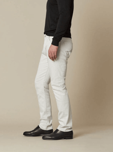 Man wearing sand colour jeans