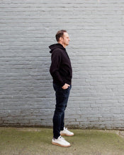 Load image into Gallery viewer, man is wearing white shoes, jeans and a black hoodie