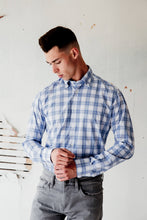Load image into Gallery viewer, man is wearing check blue and white 100% cotton shirt made in Italy by Italian brand Alex Ingh