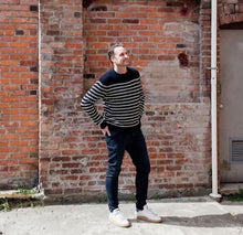 Load image into Gallery viewer, man wearing merino wool ribbed stripe navy and cream colour sweater and jeans