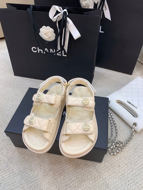 Double C creme quilted caviar sandals