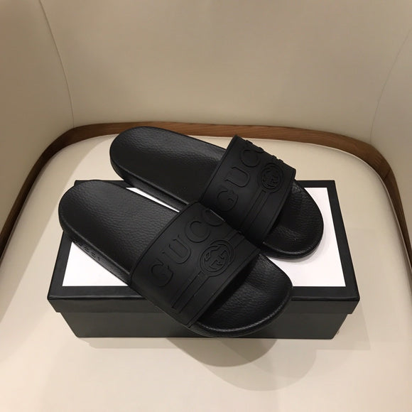 All black G unisex slides