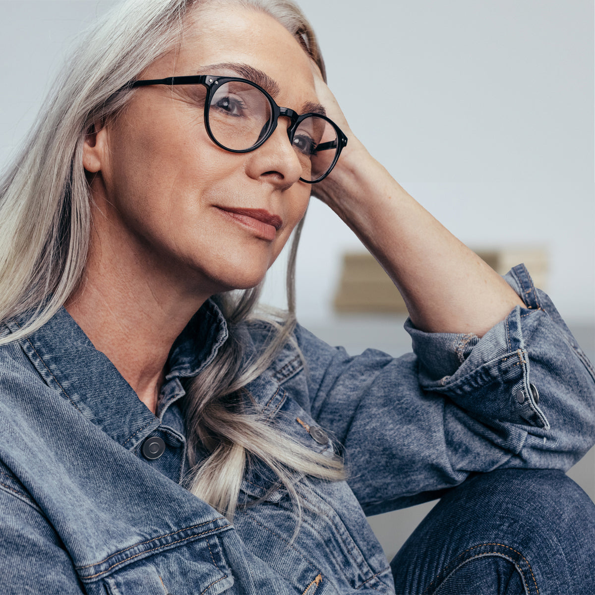 Older woman thinking and looking off camera