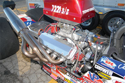 """These Borla stainless steel race headers have a muffler built into the collector for racing organizations that have maximum noise restrictions. They are also useful in bracket-style drag racing, allowing you to """"sneak up"""" on your competitor if you have the faster car."""