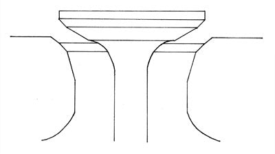 Three-angle valve job narrows the 45-degree valve seat in the head with a 30 degree top cut and a 60-degree bottom cut. Valve seat width should be a minimum of .040 to .060 inch for the intake seat, and .080 to .100 inch for the exhaust. The valve has a matching 45-degree seat and should be narrowed with a 30-degree back-cut to match the seat in the head. These angles are standard, but many cylinder head specialists have their own pet angles that work for them. Note that valve seats of 55 degrees are used in some racing heads to improve high-lift flow, with a trade-off in low-lift flow numbers.
