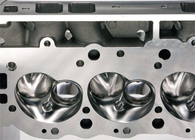 CNC machined 121-cc combustion chambers on AFR rectangular port heads feature a heart-shaped design for superior flow and combustion efficiency. This shape may require hand fitting of the dome on high-compression pistons based on the original LS6 Chevy. (Photo Courtesy AFR)