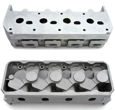 GMPP's DRCE 2 head (PN 24502585) on the left and DRCE 3 head (PN 25534404) on the right are raw castings designed for the 4.900-inch-bore-space DRCE block specified for use in NHRA Pro Stock competition. Most Pro Stock teams have developed their own port and chamber shapes, valve angles, and all other machining oper