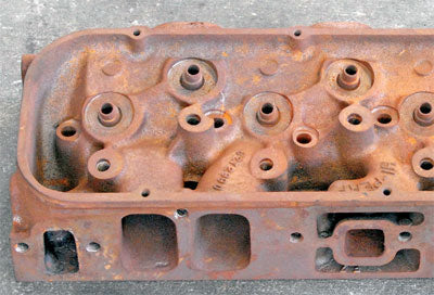 """Stock iron rectangular ports from a """"990"""" casting head. Note that the tops of the ports are almost even with the bottom of the center bolt-hole."""