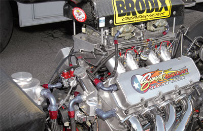 Serious engines need serious pipes. This all-aluminum Rat motor has spread port heads, sheet-metal intake manifold, and two stages of direct port nitrous. Fabshop 21⁄2-inch headers feed into a merge collector where an O2 sensor gathers data for tuning.