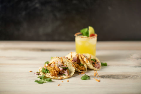 fried oyster tacos with a margarita