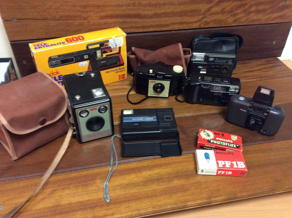 A collection of KODAK and other retro cameras and accessories.