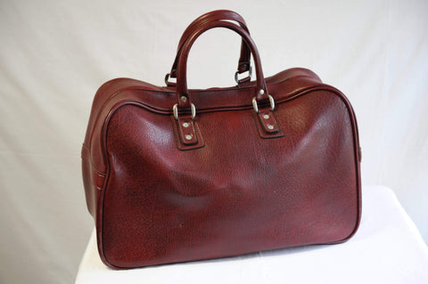 Vintage 1970s dark red weekend bag