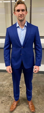 man in custom blue suit
