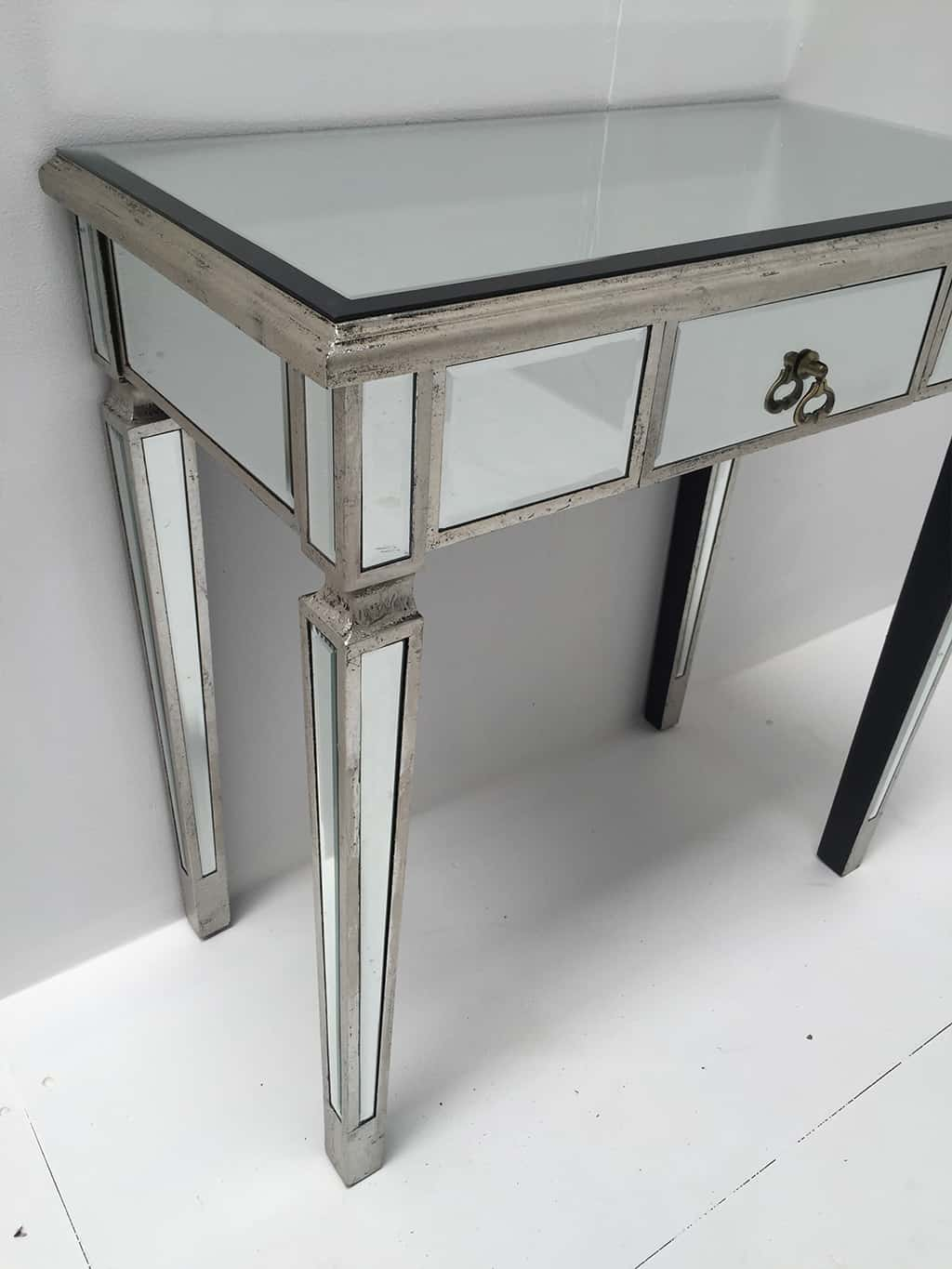 Charleston Mirrored Console Table with a single drawer, slim design, drop shaped handle, antiqued silver finish, wood and mirror