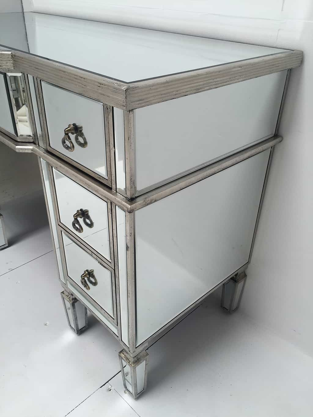 Charleston Mirrored Dressing Table with seven drawers, vintage drop ring pulls, bevelled with an antique silver wood edge.